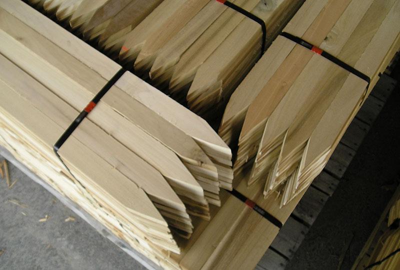 Stacks of wood stakes in bundles