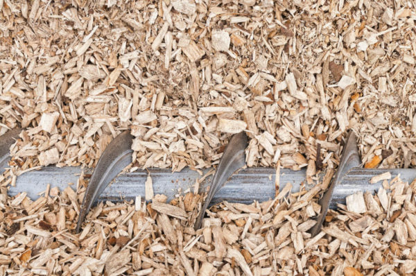 Pile of wood scrap with blade